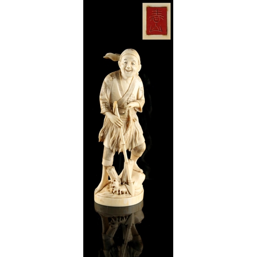 24 - Property of a lady - a Japanese carved ivory okimono depicting a fisherman harpoonist, loss to top o...