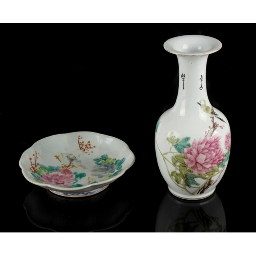 251 - A Chinese famille rose bottle vase depicting a bird among peonies, 20th century, 8.6ins. (21.8cms.) ...