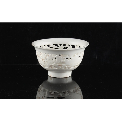 263 - A Chinese Dehua blanc de Chine pierced bowl, 18th century, 3.45ins. (8.8cms.) diameter (see illustra...