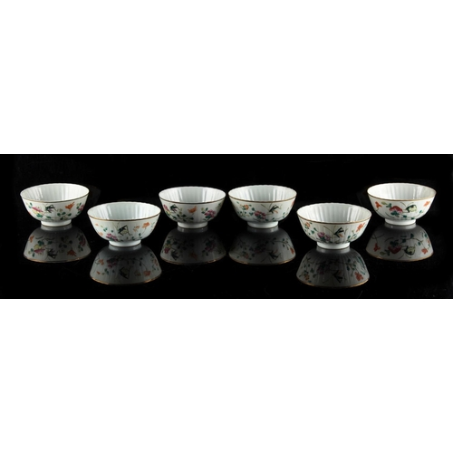 271 - A set of six early 20th century Chinese famille rose bowls, each painted with crickets & flowers, ir...