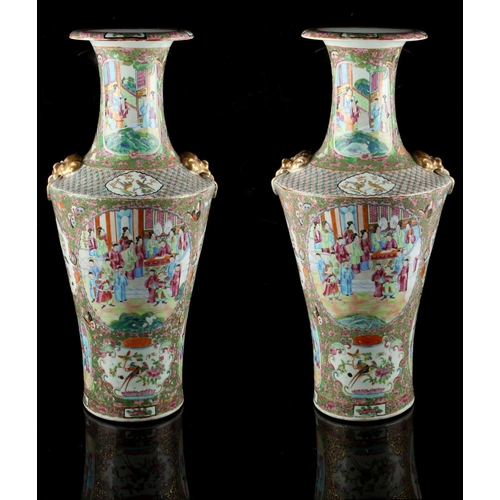 277 - A large pair of 19th century Chinese famille rose vases, each painted with panels of figures in inte...