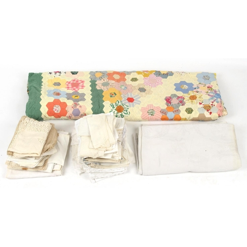40 - Property of a gentleman - a box containing assorted textiles including a patchwork quilt, 109 by 97i...