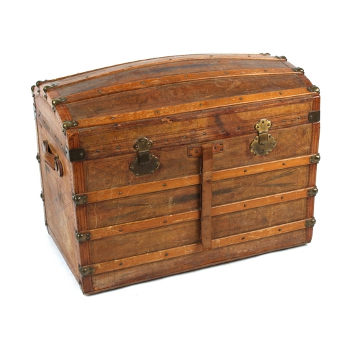 41 - Property of a deceased estate - a late 19th century tooled leather domed top trunk with fitted inter...