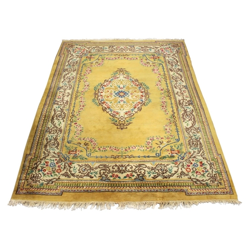 51 - Property of a gentleman - an Indian hand knotted wool carpet with pale yellow ground, 143 by 108ins....