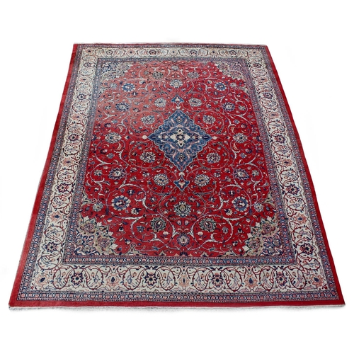 52 - Property of a gentleman - a Mahal carpet, with red ground, 156 by 120ins. (397 by 303cms.) (see illu...