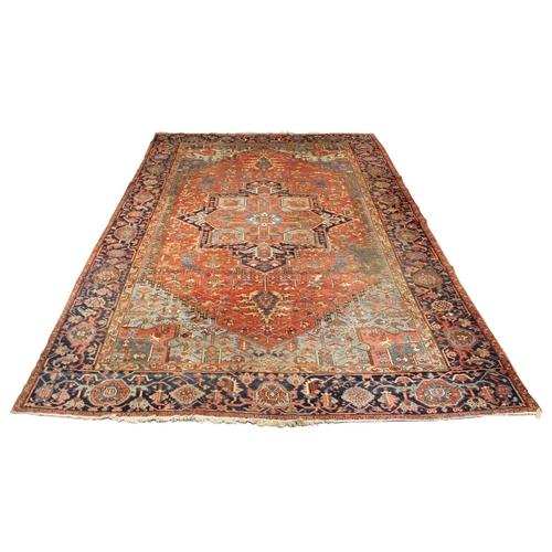 56 - Property of a deceased estate - an antique Persian Heriz carpet, late 19th / early 20th century, wit...