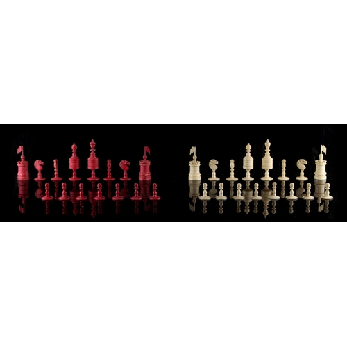 60 - Property of a gentleman - a 19th century English bone 'Old English' pattern chess set, one red pawn ...