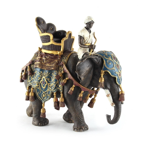 62 - Property of a lady - a cold painted bronze model of a caparisoned elephant with howdah & rider, 9ins...