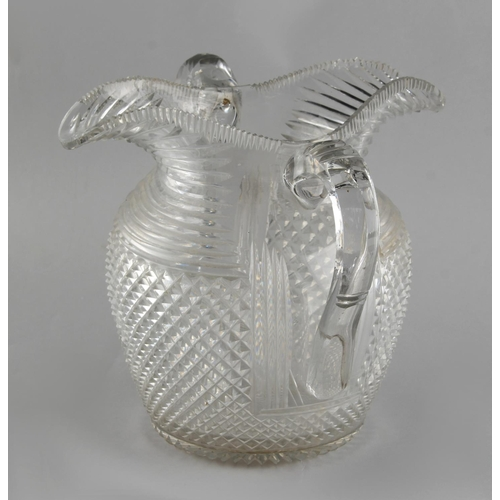 68 - Property of a lady - an unusual early 19th century cut glass double spouted water jug, possibly Iris...