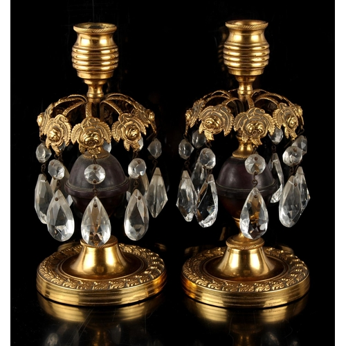 71 - Property of a lady - a pair of late 19th century French ormolu or gilt brass candlestick table lustr...