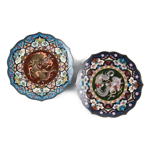9 - A pair of Japanese cloisonne barbed circular plates, circa 1900, each decorated with a central drago...