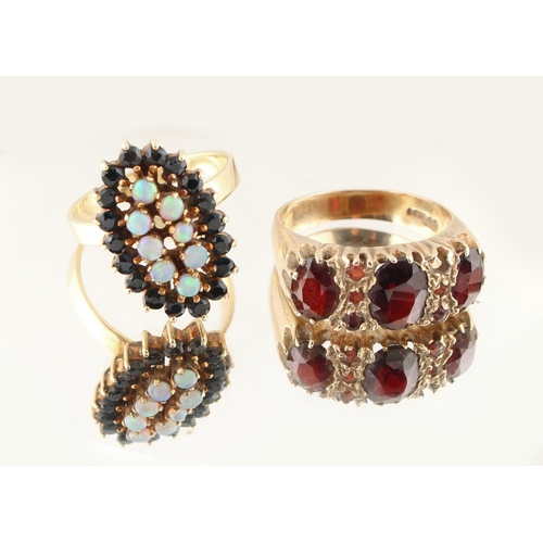 28 - Property of a lady - a 14ct yellow gold opal & sapphire oval cluster ring, approximately 4.8 grams, ...