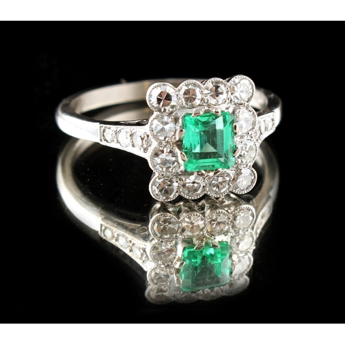 36 - A 14ct white gold emerald & diamond ring, the rectangular cut emerald weighing approximately 0.42 ca...