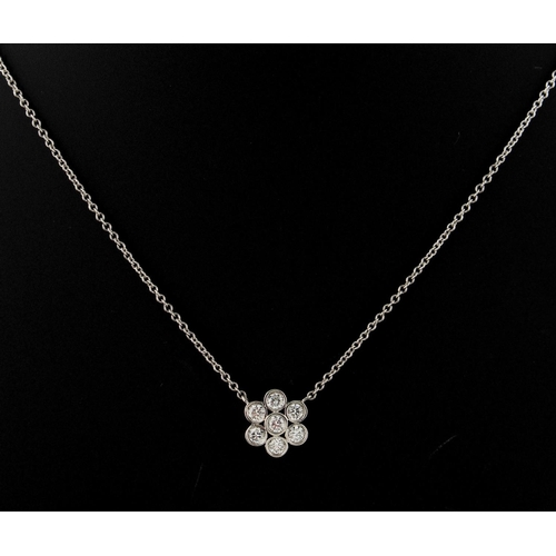 41 - A Tiffany & Co. platinum & diamond Enchant flowerhead necklace, set with seven round brilliant cut d...