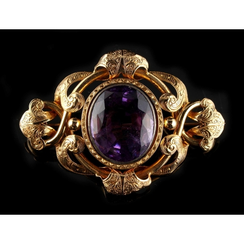 44 - Property of a deceased estate - a good Victorian unmarked yellow gold amethyst brooch, the oval cut ...