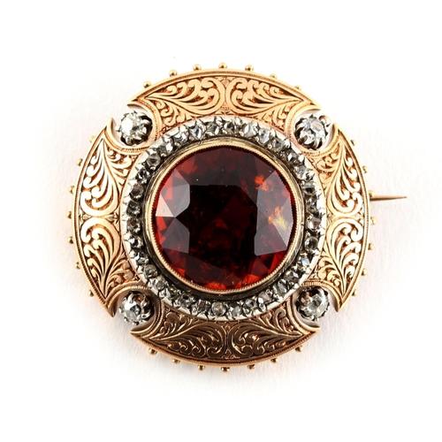 49 - A Madeira citrine & diamond circular brooch, the round cut citrine measuring approximately 17mm diam...