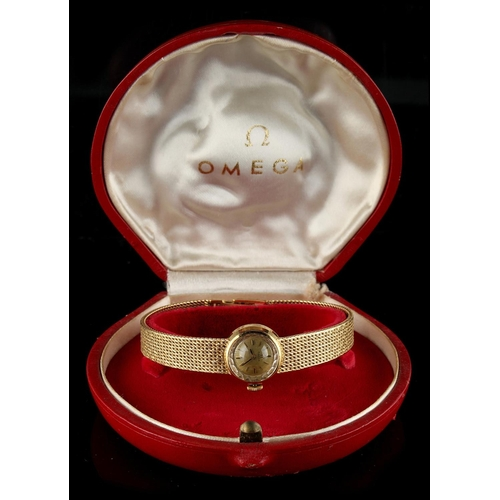 14 - Property of a deceased estate - a lady's Omega 18ct yellow gold cased wristwatch with integral 18ct ...