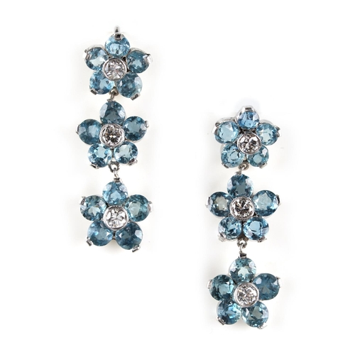 21 - An attractive pair of aquamarine & diamond pendant earrings, for pierced ears, each modelled as a st...