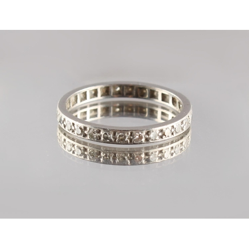 23 - Property of a lady - an unmarked platinum diamond eternity ring, size M....