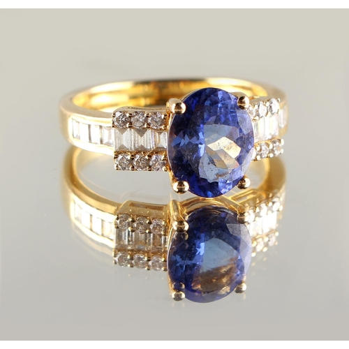 26 - Property of a lady - a 14ct yellow gold tanzanite & diamond ring, the oval cut tanzanite weighing ap...