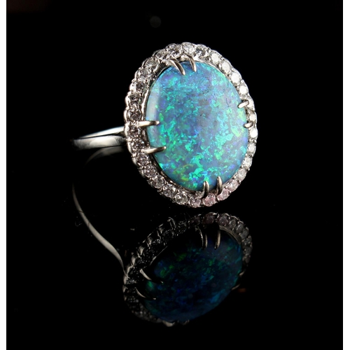 29 - Property of a lady - an Australian black opal & diamond oval cluster ring, the opal approximately 14...