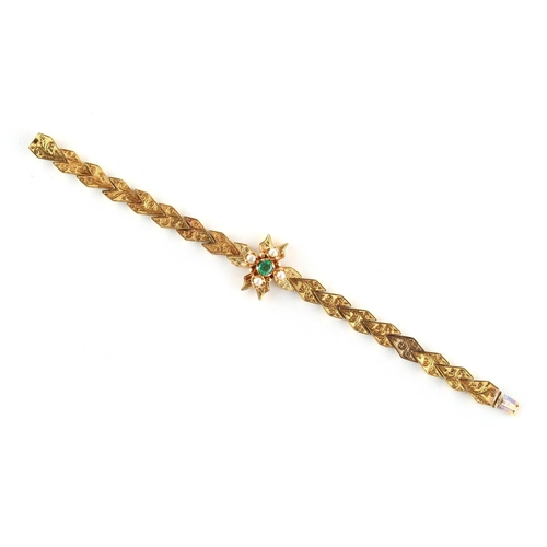 31 - A Victorian unmarked yellow gold emerald & pearl bracelet, with foliate engraved arrowhead links, ap...