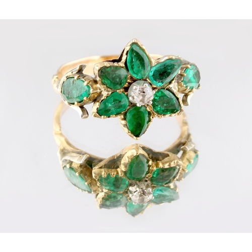 34 - A Georgian emerald & diamond flowerhead ring, with eight pear shaped emeralds flanking a small centr...