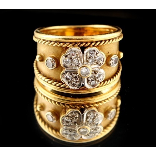 45 - Property of a lady - an 18ct gold ring of tapering band form, set with a diamond flowerhead with a f...
