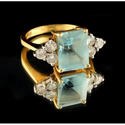 46 - Property of a lady - an 18ct yellow gold aquamarine & diamond ring, the rectangular cut aquamarine w...