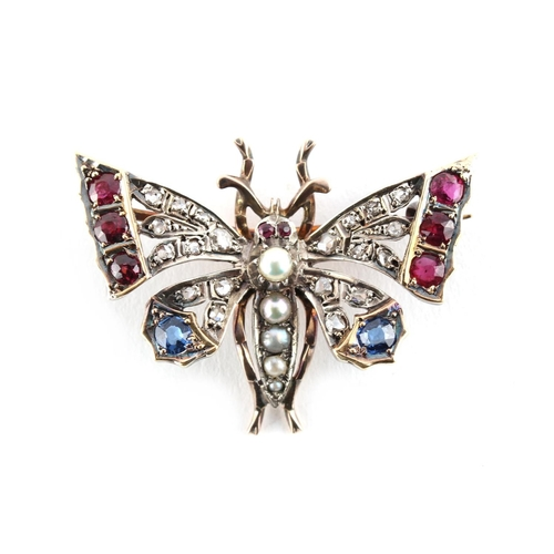 47 - A 19th century ruby sapphire diamond & pearl butterfly brooch, approximately 7.8 grams, 37mm wide....
