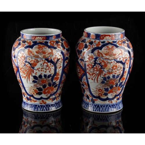 4 - Property of a lady - a pair of late 19th century Japanese Imari vases, each 9.8ins. (25cms.) high (2...