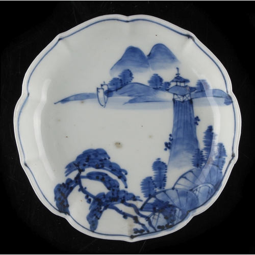 49 - Property of a lady - a Chinese blue & white ko-sometsuke dish, 17th century, with barbed rim, painte...