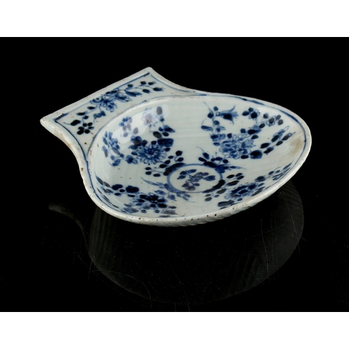 51 - A Chinese blue & white scallop shell shaped dish, 17th / 18th century, 6.4ins. (16.2cms.) wide....