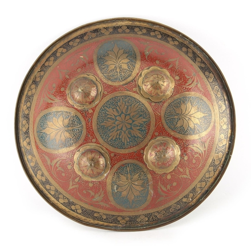 14 - Property of a gentleman - a late 19th century Indian brass small shield, dhal, with four flowerhead ...
