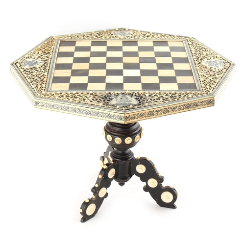 21 - Property of a lady - a 19th century Indian Vizagapatam ivory & ebony octagonal topped miniature ches...