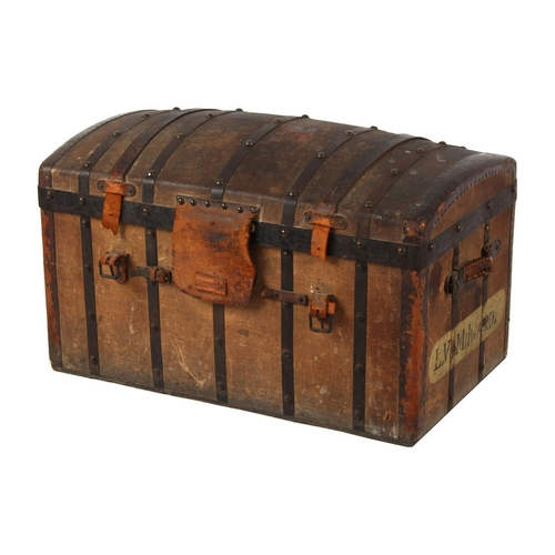 31 - Property of a lady - a late 19th / early 20th century metalbound canvas domed trunk, with interior t...
