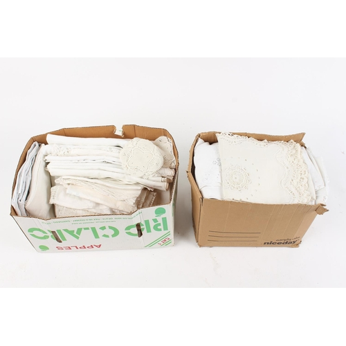 33 - Property of a deceased estate - two boxes containing damask tablecloths, etc. (2)....