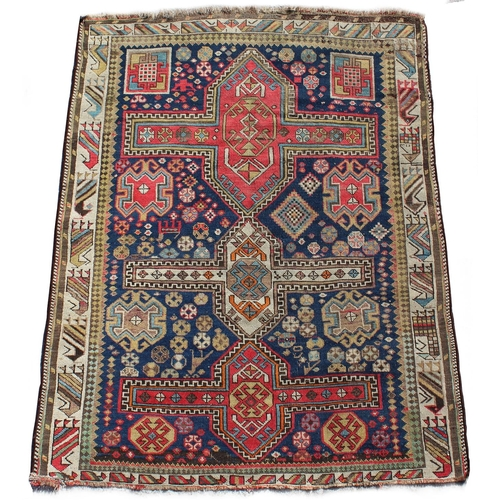 38 - Property of a deceased estate - a late 19th century Caucasian Kazak rug, 59 by 46ins. (150 by 117cms...