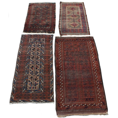 41 - Property of a deceased estate - four early 20th century Belouch rugs including a prayer rug, the lar...