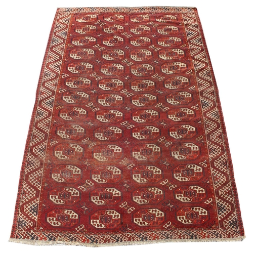 42 - Property of a gentleman - an early / mid 20th century Turkoman carpet, 112 by 76ins. (284 by 193cms....