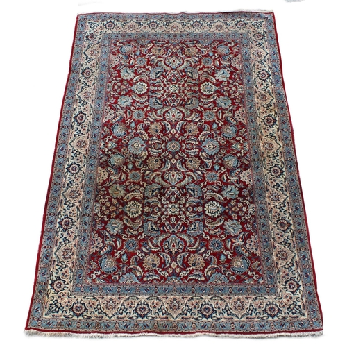 43 - Property of a deceased estate - a Kashan rug, with burgundy field, approximately 87 by 57ins. (222 b...