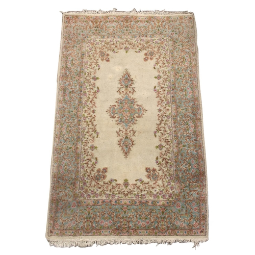 44 - Property of a deceased estate - a Persian Qum rug with floral pattern on an ivory ground with pale b...