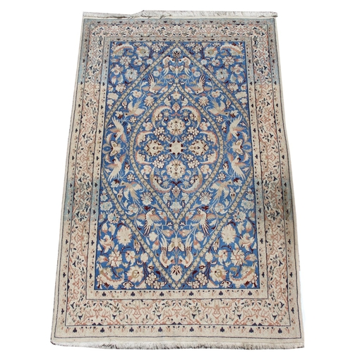 48 - Property of a gentleman - a Persian Qum rug with pale blue & ivory ground, 79 by 49ins. (210 by 125c...