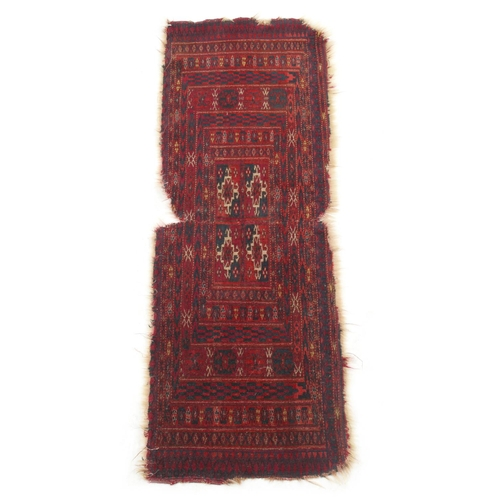 52 - Property of a deceased estate - an antique Esari mat, 37 by 14ins. (94 by 35cms.)....