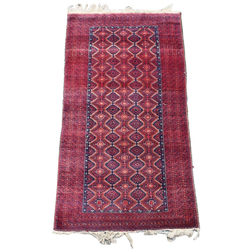 53 - Property of a deceased estate - an early / mid 20th century Turkoman rug, 71 by 38ins. (181 by 97cms...