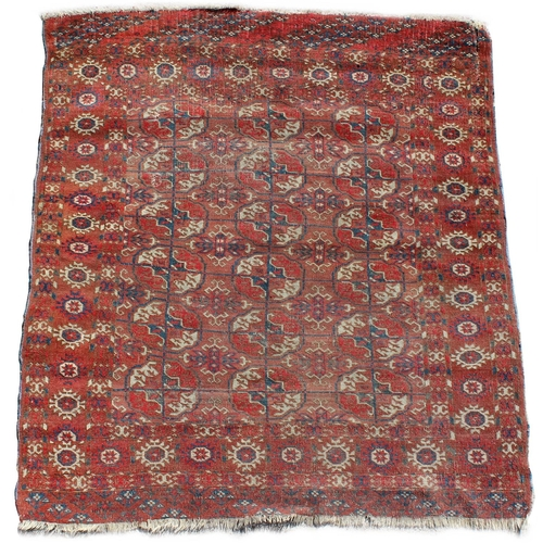 55 - Property of a deceased estate - an early 20th century Turkoman rug, 49 by 44ins. (125 by 112cms.)....