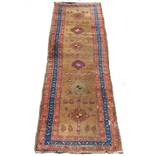 57 - Property of a deceased estate - a late 19th / early 20th century antique Caucasian long rug, with po...