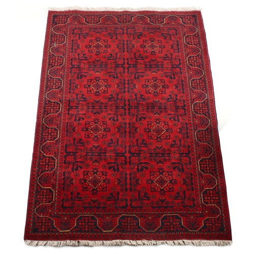 59 - Property of a gentleman - a modern Turkoman design hand-knotted wool rug, with burgundy ground, 73 b...