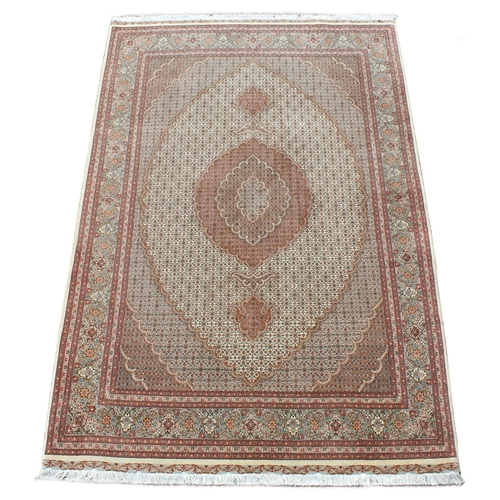 60 - Property of a gentleman - a Persian Tabriz wool & silk small carpet, with ivory ground, 98 by 67ins....