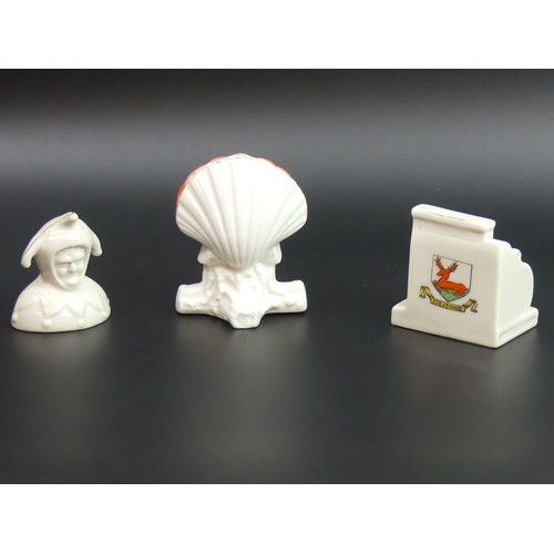 4 - Three items of crested china, viz. A National cash register Stevenage, Gt. Yarmouth Jester and a bla...